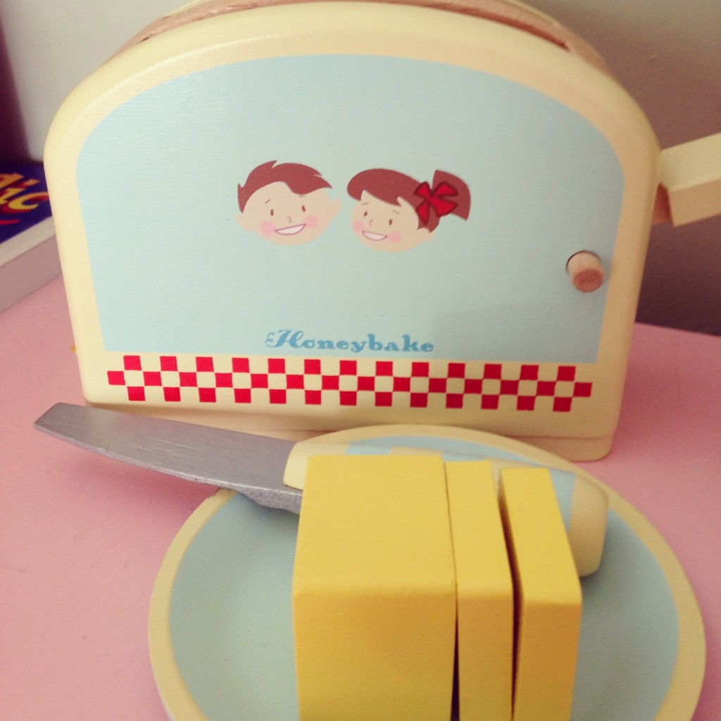 yellow wooden toaster set