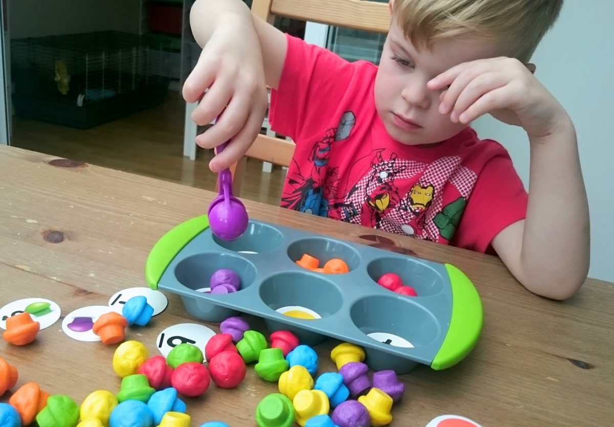 Little Man playing Mini Muffin Maths set